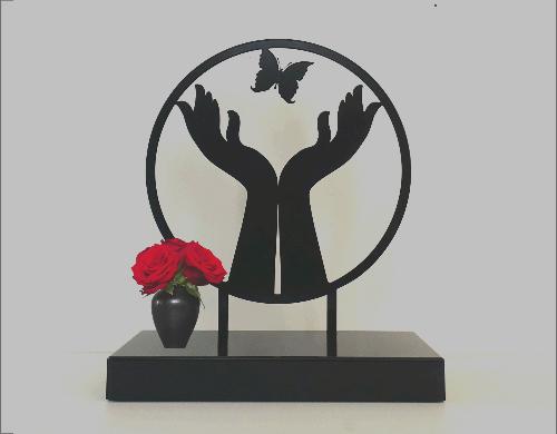 urn kopen handen vlinder